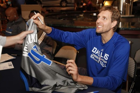 """DALLAS, TX - OCTOBER 4: Dirk Nowitzki #41 of the Dallas Mavericks signs autographs for fans during the Dallas Mavericks """"Fan Jam"""" on October 4, 2014 at the American Airlines Center in Dallas, Texas. NOTE TO USER: User expressly acknowledges and agrees that, by downloading and/or using this Photograph, user is consenting to the terms and conditions of the Getty Images License Agreement. Mandatory Copyright Notice: Copyright 2014 NBAE (Photo by Glenn James/NBAE via Getty Images)"""
