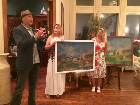 Rolando explains the giclee printing process while Dena and Miller play Vanna White. Photo by Kate Tollesfrud.