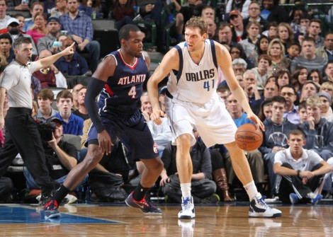 DALLAS, TX - DECEMBER 22: Dirk Nowitzki #41 of the Dallas Mavericks posts up against Paul Millsap #4 of the Atlanta Hawks on December 22, 2014 at the American Airlines Center in Dallas, Texas. Copyright 2014 NBAE (Photo by Danny Bollinger/NBAE via Getty Images)
